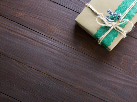 paper art: Handmade christmas gift box on wooden table with copy space