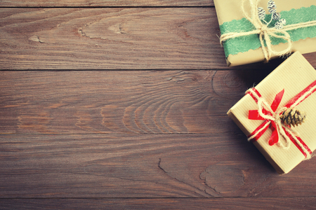 december: Handmade christmas gift boxes on wooden table with copy space Stock Photo