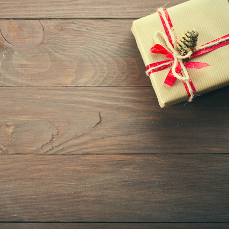 design objects: Handmade christmas gift box on wooden table with copy space