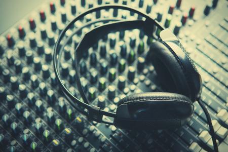 entertainment industry: Headphones on soundmixer