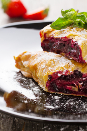 christmas paste: Strudel with blackberry close-up