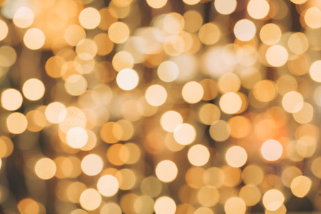 Abstract defocused orange sparkles background