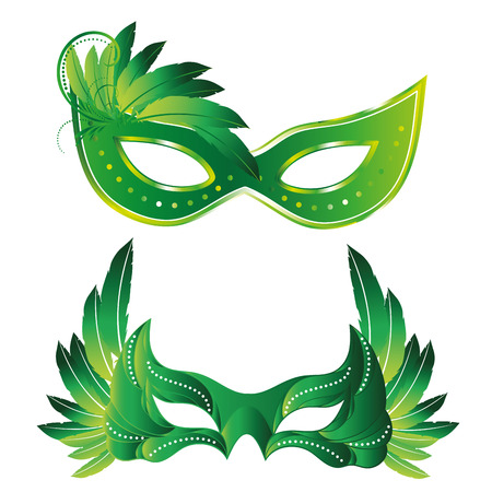 a pair of green carnival masks with some feathers in them