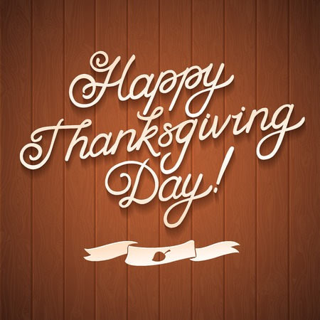 Happy Thanksgiving day. Congratulation calligraphy on wooden background