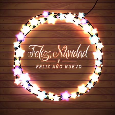 spanish language: Merry Christmas and Happy New Year. Spanish Language. Glowing Christmas Lights Wreath for Xmas Holiday Greeting Card Design. Wooden Hand Drawn Background.