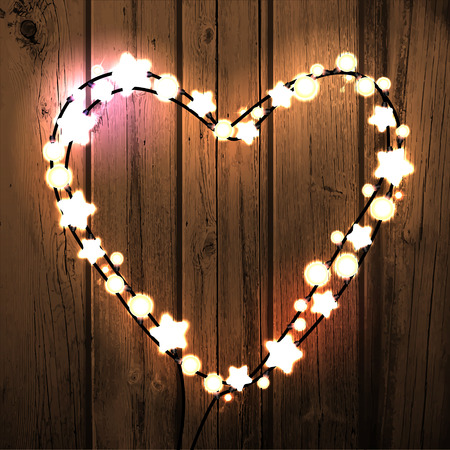 bright lights: Happy Valentine`s Day. Wood Background with Bright Lights Garland Heart Shape.