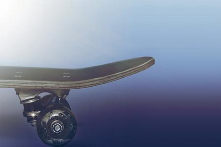 Skateboard on blue background toning