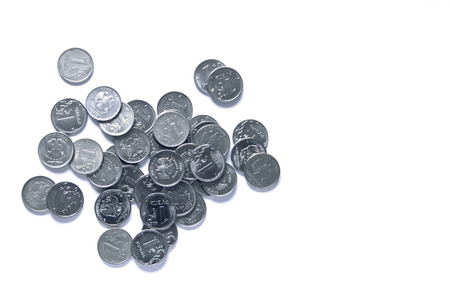 silver background: A handful of silver coins on a white background