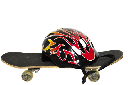 Skateboard and helmet on white background isolates