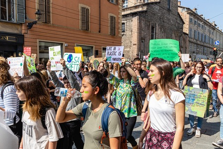 Parma, Italy - 24 may, 2019: strikers with banners, global climate strike