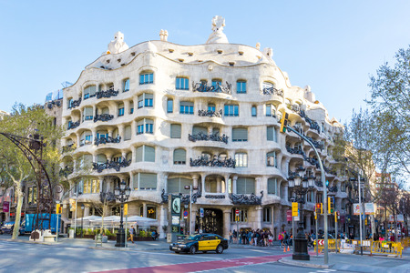 BARCELONA, SPAIN - APRIL 2, 2015: Casa MIla is building famous architect Antonio Gaudi, view from outside, Barcelona, Spain Editorial