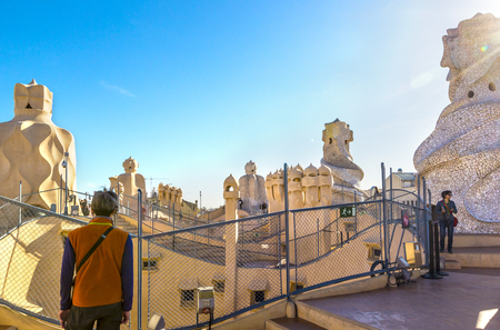 BARCELONA, SPAIN - APRIL 2, 2015: Casa MIla is building famous architect Antonio Gaudi, view from outside, details of roof and chimney, Barcelona, Spain