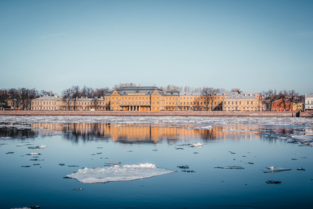 St. Petersburg granite embankment, panoramic view from Neva River on cityscape and architecture of city,  spring ice drift, Saint Petersburg, Russia.