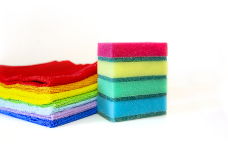 Brightly multicolored cleaning sponges and rags on white background