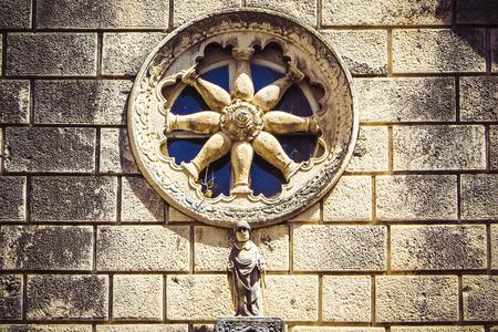 Stone facade of old catholic church with round window, Dubrovnik, Croatia Stok Fotoğraf