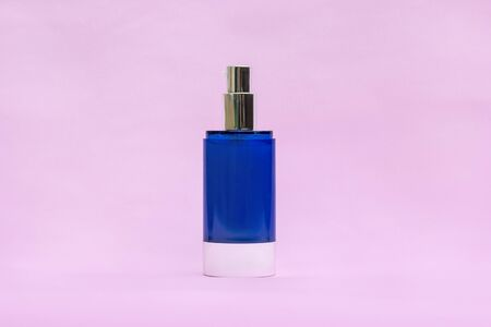 Blank blue cream jar on light background. Cosmetic skincare products, modern concept of organic beauty trend.