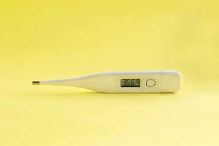Digital medical thermometer with temperature of 36.6 on Stock fotó