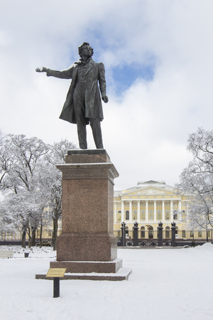 Monument statue to Aleksander Pushkin on Square of Arts near Russian Museum, in winter with snow-white trees, St Petersburg, Russia. Sculptor  M. K. Anikushin, architect V.A. Petrov.