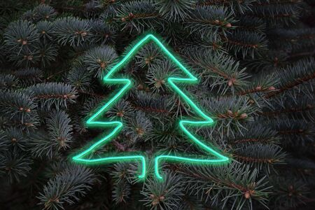 New Year composition - neon luminous christmas tree on natural spruce branches of background, fluorescent creative greeting card
