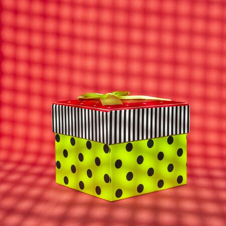 Beautiful gift box with stripes and polka dots on red background minimalistic style. Concept for christmas, new year, birthday