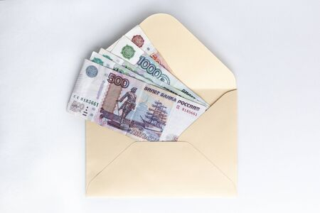 Banknotes of rubles, cash money in envelope on white background. Money savings concept. Stock fotó - 132701881
