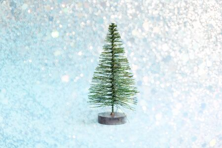 Christmas tree on light blue shiny background with snowflakes in minimal style. Christmas ornaments, new year and winter concept. Stock fotó - 132993760