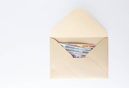 Banknotes of rubles, cash money in envelope on white background. Money savings concept.