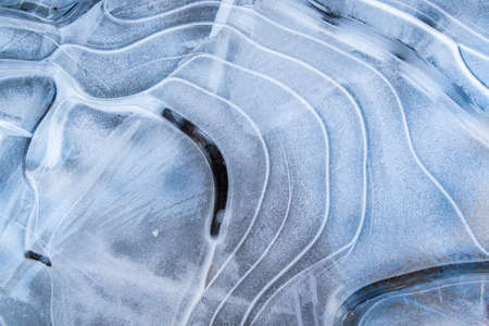 Beautiful abstract icy background. Natural texture of light blue ice structure and snow. Stock fotó
