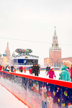 Moscow, Russia - February 21, 2021: GUM ice rink on Red Square with colorful lights on snowy winter day in Moscow, Russia
