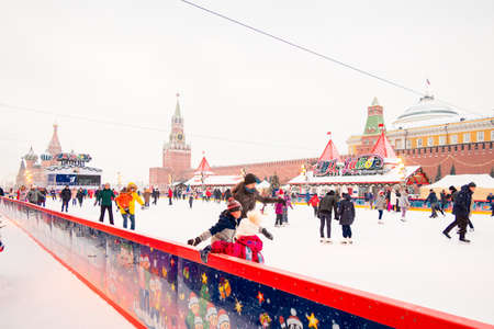 Moscow, Russia - February 21, 2021: GUM ice rink on Red Square with colorful lights on snowy winter day in Moscow, Russia. 新聞圖片