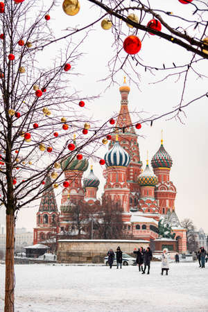 Moscow, Russia - February 21, 2021: Saint Basil's Cathedral in center city on Red Square in snowy winter, Moscow, Russia.