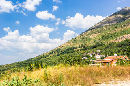 Panoramic view of beautiful landscape mountains and of small haven of village, Adriatic coast, Montenegro