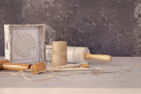 Professional working tools for working with clay, plasticine and botanical bas-relie leaf. Pottery shovels, brushes, rolling pin on marble table