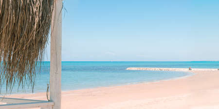 Beautiful landscape with white sand beach. Panoramic view on blue sky and azure coast sea on natural background. Luxury summer vacation