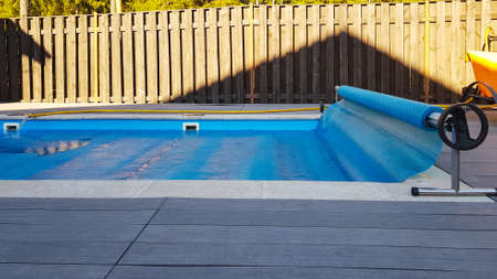 Swimming pool cover for protection against dirt, leaves, heating and cooling water, copy space