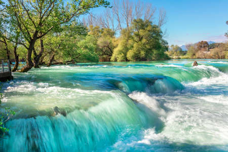 Beautiful natural landscape of Manavgat waterfall in national park on sunny spring day. Unique azure water color with splashes, Side, Antalya, Turkey. High quality photo 版權商用圖片