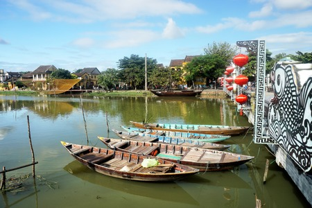 Wooden boats on the Thu Bon River in Hoi An