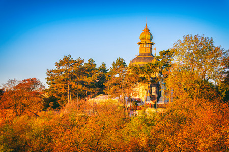 Autumn in Prague, favorite tourist destination Letna park (Letenske sady), colorful landscape with blue sky, Czech Republic