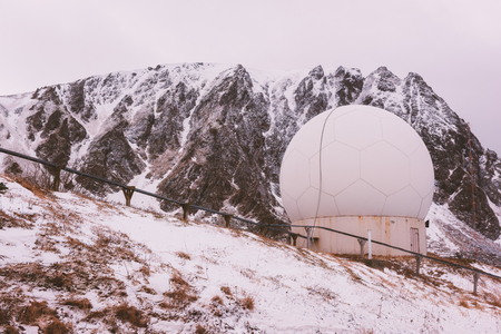 Weather doppler radar station in the winter landscape