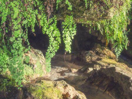 Natural dark cave with flowing water in Krka National Park, Croatia