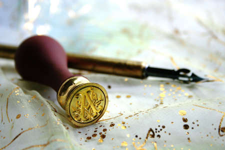 Calligraphy pen and wax seal with monogram
