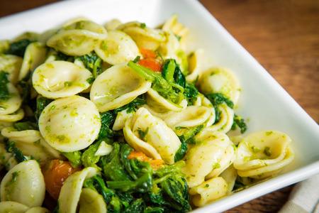 Orecchiette pasta with broccoli rabe and red pepper  photo