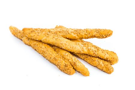 Sesame breadsticks on white background