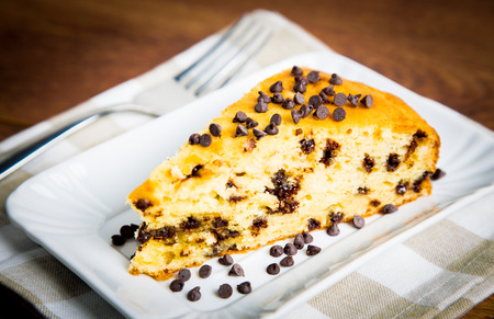 choco chips: Slice of delicious homemade cake with pears and choco chips on wooden table