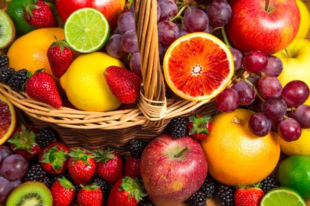 Mix of fresh fruits on wicker basket