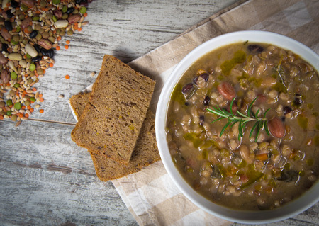 Vegetable soup with pumpkin and onion served with toasted brown bread photo