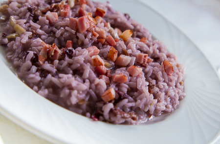 Risotto creamed with barolo with radicchio and crispy bacon