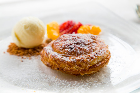 Apple pie in puff pastry served with ice cream and candied fruit