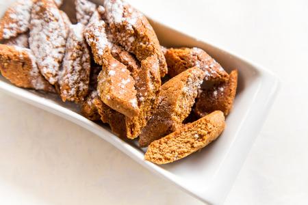Cantucci biscuits flavored cinnamon with powdered sugar Archivio Fotografico