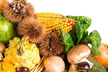 Autumn harvest - fresh autumn fruits and vegetables on wicker basket on white background Stock Photo